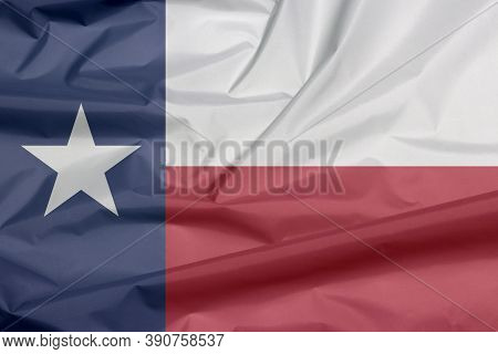Fabric Flag Of Tennessee. Crease Of Tennessee Flag Background, Blue Containing A Single White Star.