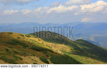 Sunny slope of mountain valley in Carpathians, Ukraine