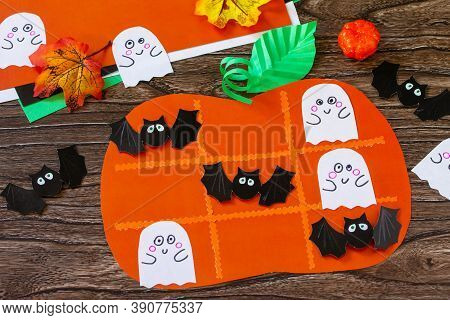 Halloween Concept Funny Paper Toy In The Shape Of A Pumpkin. Childrens Art Project, Crafts, Fun Acti