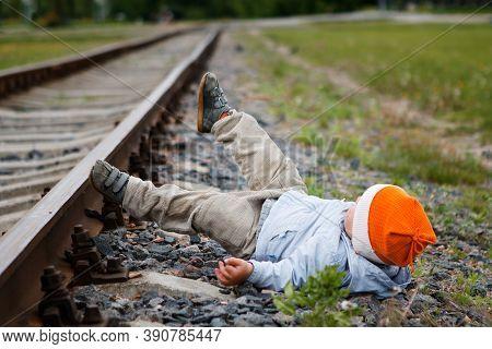 Dangerously. Little Boy On The Train Tracks