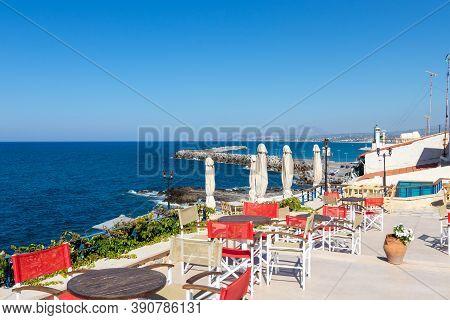 Rethimno, Greece - August 11, 2020 - Empty Tables In A Restaurant In Rethymnon On The Greek Island O