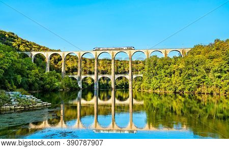 Regional Train On The Cize-bolozon Viaduct Across The Ain Gorge In France