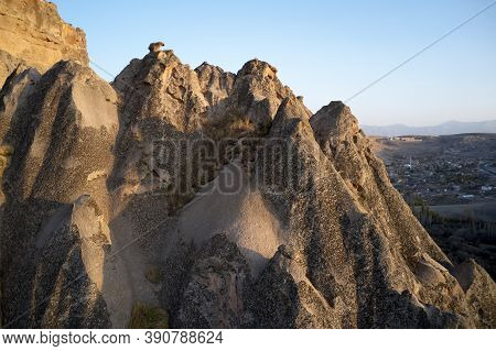 Unique Geological Formations At Cappadocia, Turkey. Cliffs Cave Dwellings Carved Into The Stone Form