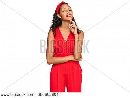 Young african american girl wearing elegant and sexy look looking confident at the camera with smile with crossed arms and hand raised on chin. thinking positive.