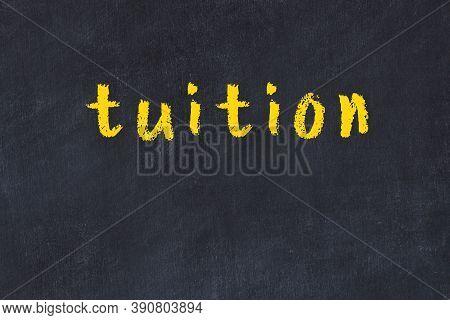 Chalk Handwritten Inscription Tuition On Black Desk
