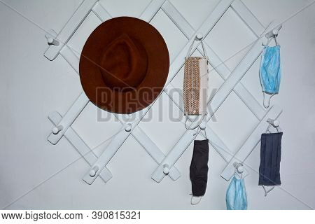 White Corridor Cloakroom With Many Hanging Respiratory Protection Masks For The Whole Family Or To C