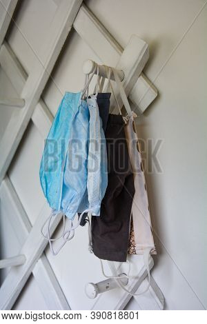 White Hallway Cloakroom With Many Hanging Respiratory Masks