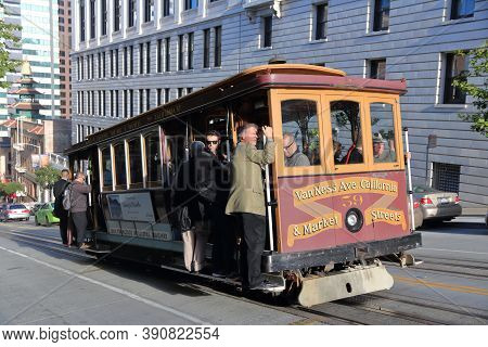 San Francisco, Usa - April 9, 2014: People Ride Historic Cable Car In San Francisco, Usa. Famous Sf