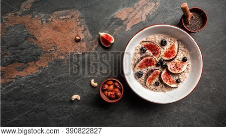 Healthy Diet Breakfast. Overnight Oatmeal With Chia Seeds And Fruits Figs, Strawberries, Gluten, Lac