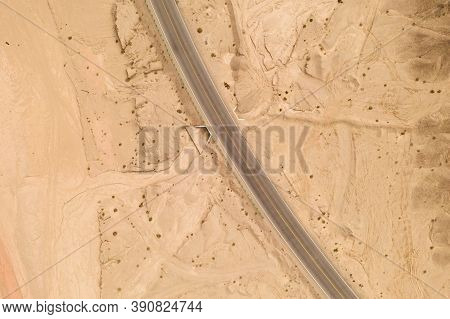 Dryness Land With Erosion Terrain With Highway Crossing.