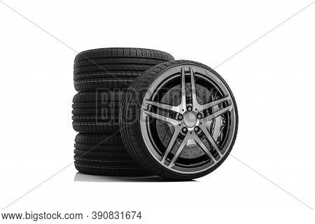 Car Tires On A White Background. Four Wheels.