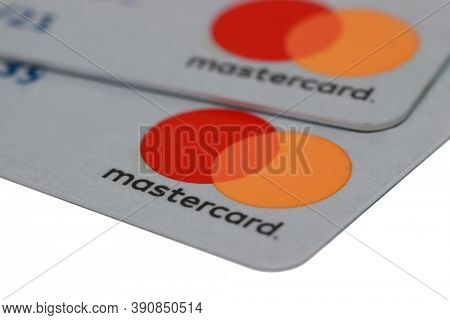 Detroit, MI / USA -August 16, 2020: Close up of a two grey color  master cards on white background