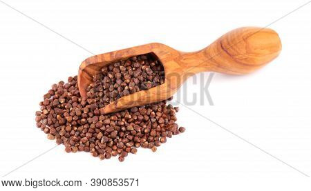 Guinea Pepper Grains In Wooden Scoop, Isolated On White Background. Melegeta, Alligator Pepper Or Ma