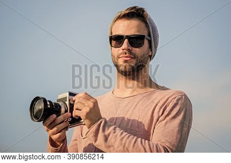 Bring Creative Colours To Your Life. Photographer In Glasses. Travel With Camera. Male Fashion Style