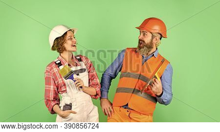 Cheerful Couple Renovating House. Woman Builder Hard Hat. Man Engineer Or Architect. Interior Renova