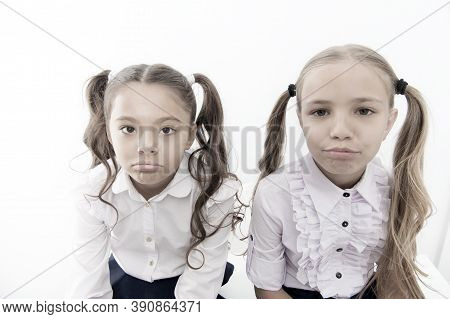 Unhappy Cuties. Unhappy Little Schoolchildren Isolated On White. Adorable Small Girls With Unhappy E
