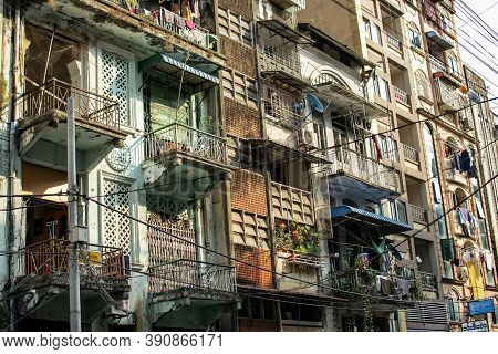Exterior Facade Of An Old Residential Apartment Building In Downtown Central Yangon/rangoon, Myanmar