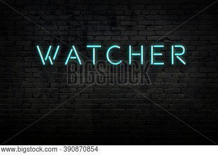 Neon Sign On Brick Wall At Night. Inscription Watcher