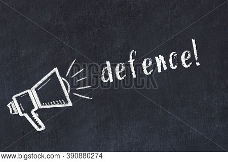 Chalk Drawing Of Loudspeaker And Handwritten Inscription Defence On Black Desk