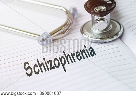 Schizophrenia And Psychotic Concept Schizophrenia. Text On A Medical Card Next To A Pen Stethoscope.