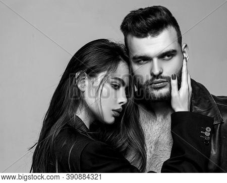 Man Brutal Well Groomed Macho And Attractive Feminine Girl Long Hair Cuddling. Girlfriend Passionate