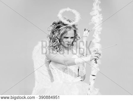 Cute Little Cupid Shoots A Bow. Portrait Of A Cupid Little Girl. Pretty White Little Girl As The Cup