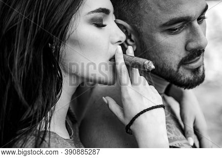 Cuban Cigar. Sensual Latino Couple. Latin Men Enjoing And Relaxing With Love Women. Couple Enjoy In