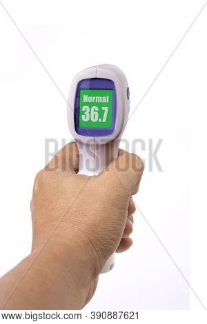 Hand Holding Handheld Infrared Thermometer That Showing Body Temperature On White Background.