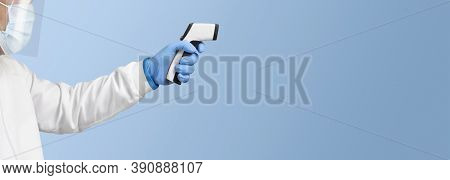 The Doctor Is Measuring Temperature With An White Infrared Thermometer On A Blue Color Background ,