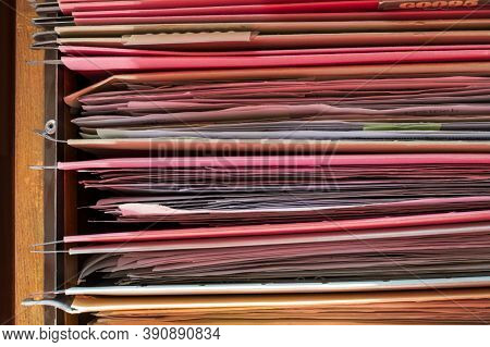 Colorful Folders Are Arranged In A File Cabinet.
