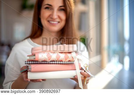 Happy Young Woman Collecting The Daily Personal Journal And Notebooks From The Stationary Shop.