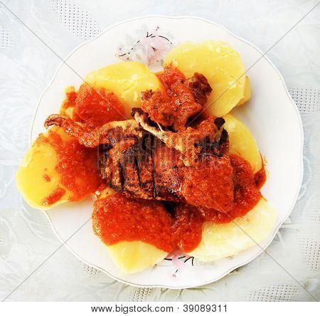 Cuy con papas - traditional peruvian food