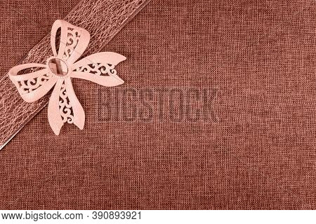 Elegant Coral Glitter Tied Bow On Coral Colored Ribbon And On Coral Natural Burlap. Horizontal Greet