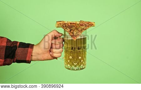 Take It. Male Hand Hold Glass Of Beer And Slice Of Pizza On. Perfect Rest In Pub. Eat Pizza And Drin