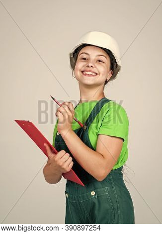 Nice Smile. Repair Planning. Kid In Hard Hat Making Notes. Child Hold Document Folder. Kid Learn How