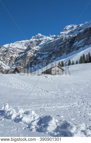 Alpine Huts And Alpstein Massif With Mountain Saentis In Winter, Canton Appenzell-ausserrhoden, Swit