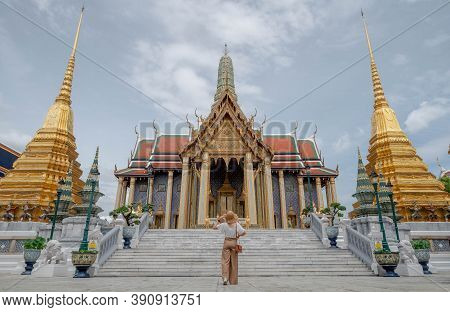A Young Pretty Asian Woman Wearing Hat Is Travel Around Famous Places In Bangkok City , No Traveler