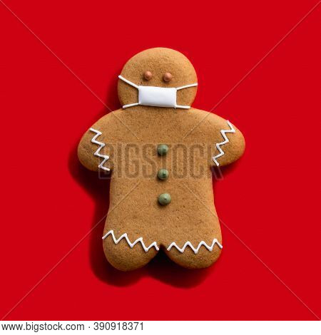 Pandemic Christmas. Quarantine Celebration. Covid-19 Winter Holidays. Brown Gingerbread Man In Prote