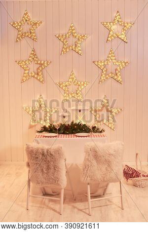 Dining Room Decorated For Christmas. Table With Chairs Set, Waiting For Guests. The Wall Is Decorate