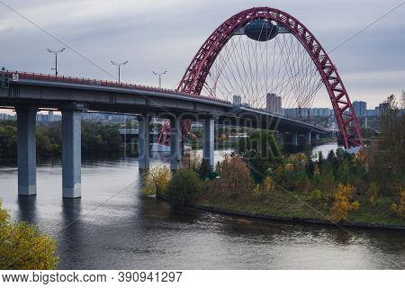 Scenic View Of The Zhivopisny Bridge In Moscow, Russian Federation. Photo Shoot Of Red Arch, Steel C