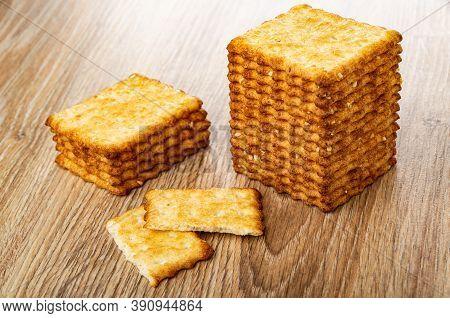 Stacks Of Crunchy Cookies With Sesame, Broken Cracker On Wooden Table