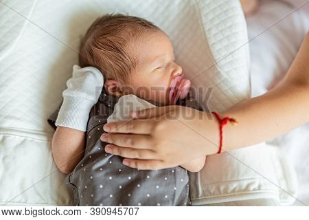 Newborn Baby In White Cocoon. Sister Holding Newborn Baby. Health Care, Hygiene, Happy Family Concep