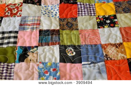 Closeup Of Flat, Handmade Patchwork Quilt Fabric