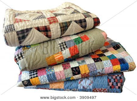 Stack Of Handmade Quilts On White With Path