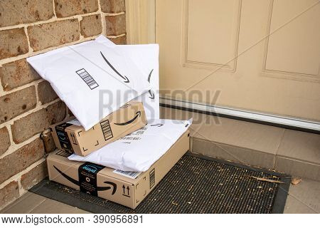 Sydney, Australia - 2020-10-17 Amazon Prime Boxes And Envelopes Delivered To A Front Door Of Rededen