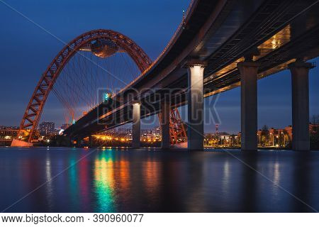 View Of Zhivopisny Bridge In Moscow, Russian Federation. Photo Shoot Of The Red Arch, Steel Cable-st