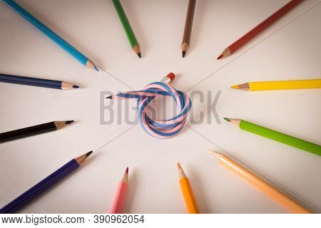 Flexible Pencil And A Set Of Colored Pencils On A Light Background. Selective Focus