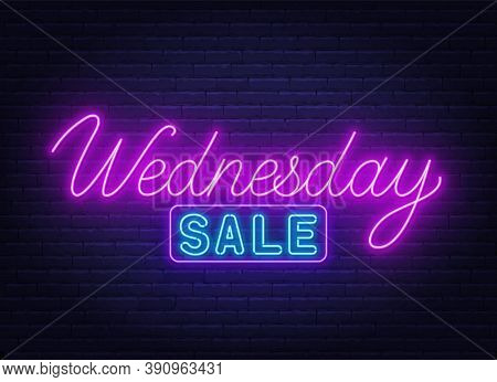 Wednesday Sale Neon Sign On Brick Wall Background.