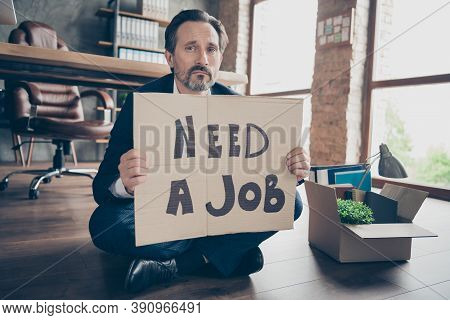 Portrait Of His He Depressed Jobless Guy Banker Sitting On Wooden Floor Holding Placard Need A Job W