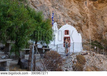 Perrisa, Greece - 18 September 2020: Tourist Taking A Photo At Panagia Katefiani On Path To Ancient